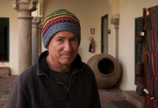 man wearing a colorful hat woven in wool, alpaca
