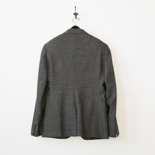 Used suit - back view on hanger
