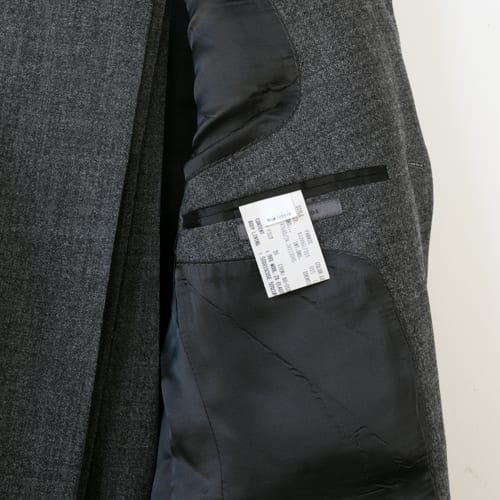 Tag inside suit jacket