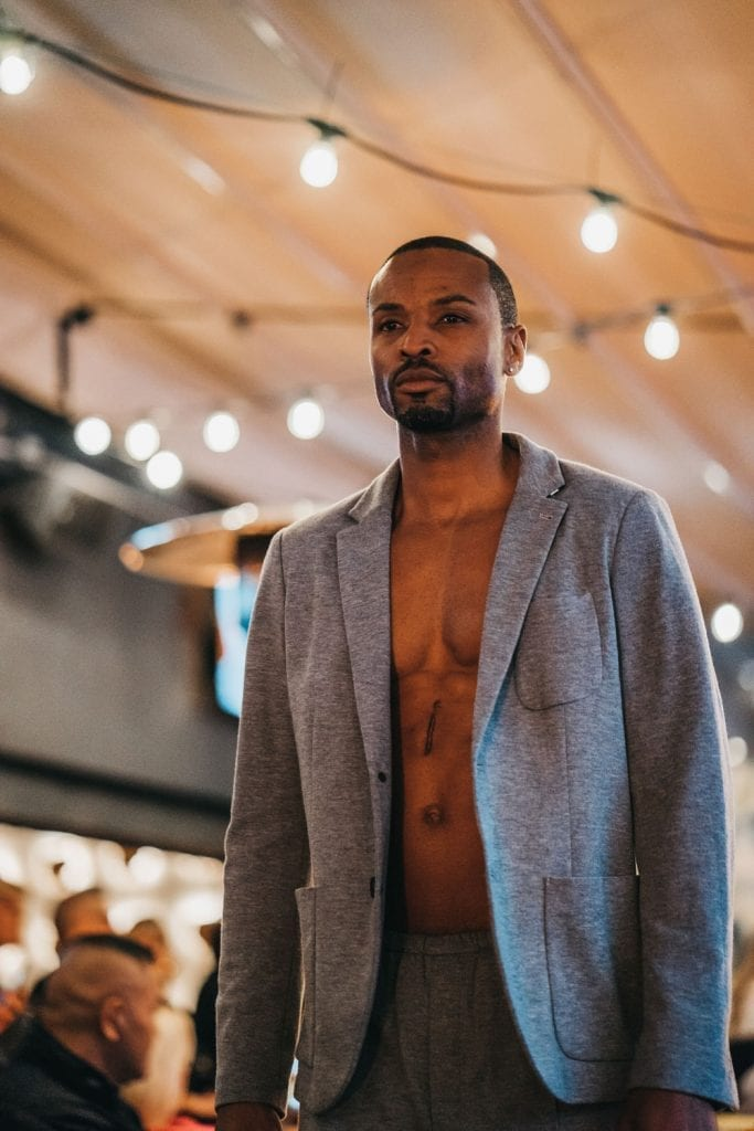 runway show, suit without shirt