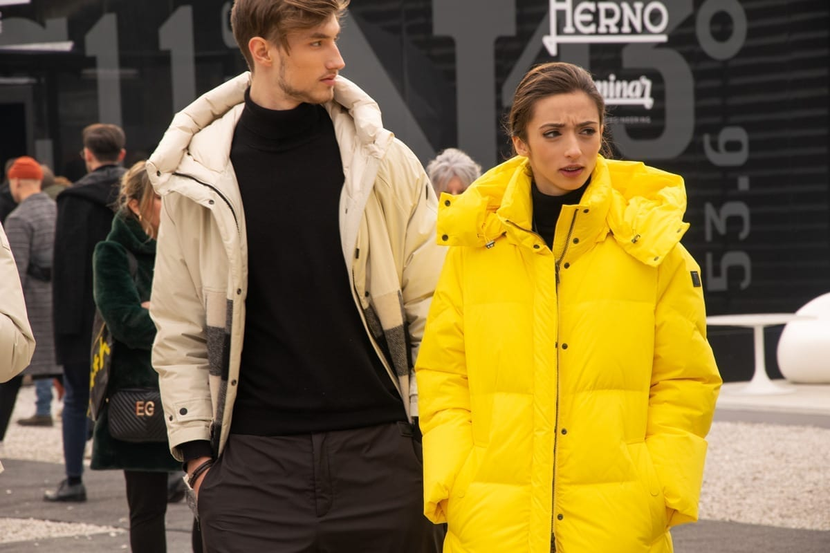 man and woman wearing outdoor parkas, italy